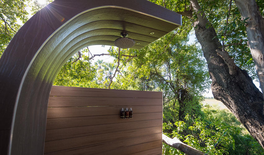 Private outdoor showers nestled amongst the trees
