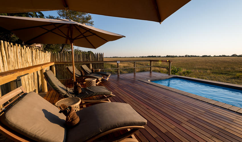 A plunge pool with comfortable loungers